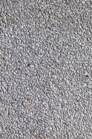gravelly: white gravelly and concrete wall render, background texture  Stock Photo