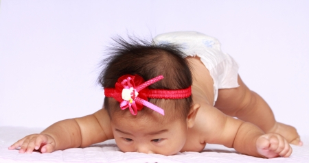 asian angel: asia baby try to crawl. she is my daugther.