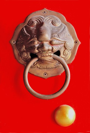 Ancient chinese door knocker at chinese temple in Pattaya Thailand. Stock Photo - 7608500