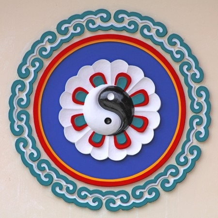 yang style: Chinese pattern logo on the wall of chinese temple in Pattaya Thailand.