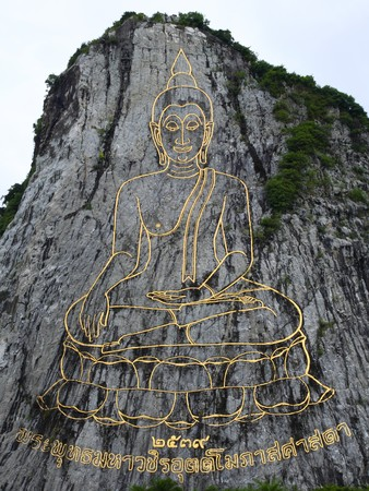 Buddha laser carved on a mountain, Cheejan mountain, Thailand  photo
