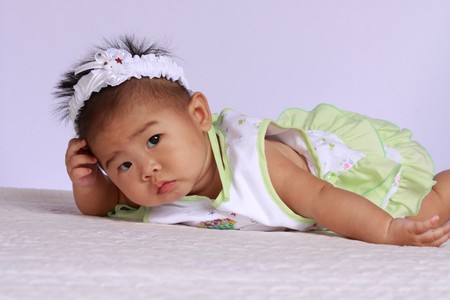 suspicious Beautiful Asian Infant Baby .she is my daughter photo
