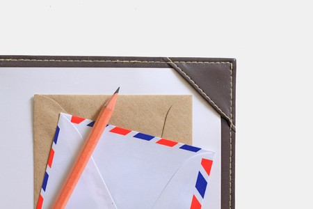 Letter paper, envelope and a wooden pencil isolated in white. photo