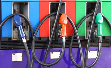 ethanol: Gas nozzles at the gas station A row of 3 different gas pumps red green and blue