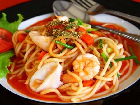 seafood spaghetti with tomato sauce.