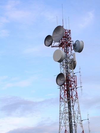 telecommunications tower with many satellite dish photo