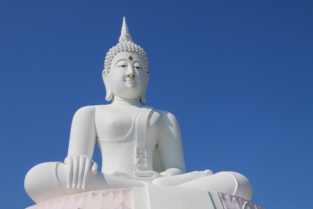 white buddha statue with blue sky. photo