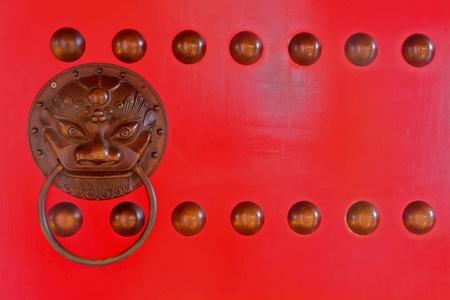 Brazen Chinese lion head door knocker photo