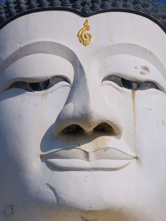 Close up shot of the smile Buddhas face photo