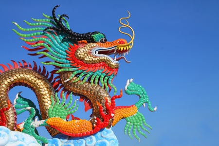 beautiful chinese dragon statue with blue sky Stock Photo