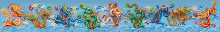 nine chinese dragon statue on the wall of chinese temple, Thailand. Geat dragon wall. photo