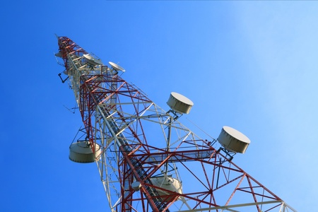 Telecommunication tower with rich blue sky photo