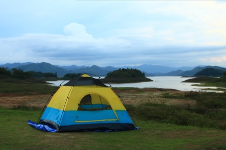 camping site at lake side with evening sky