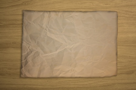 Old brownd paper on the wood background. Stock Photo - 11222347
