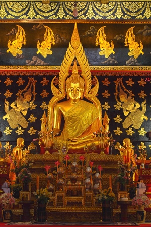 Attractively golden Buddha in Thai temple. photo