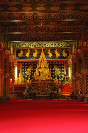 Golden Buddha in Attractively decorated temple. photo