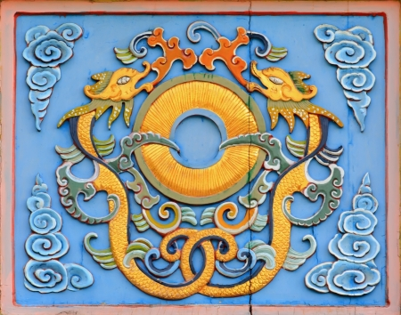 Chinese Dragon Symbol on a temple wall photo
