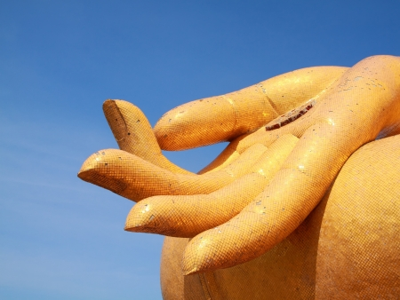 gold fingers of  big buddha statue in temple ,thailand photo