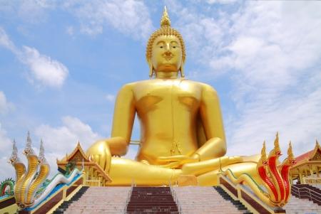biggest golden Buddha statue in a Buddhist temple, Thailand  photo