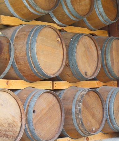wall of wooden barrels on a rack  photo