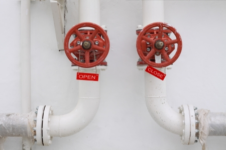 wellhead: conceptual  pipeline wellhead with open and close label Stock Photo