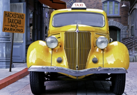 singapore May 5, 2012  A yellow vintage taxi car
