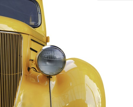 front bumper: A yellow retro car headlight closeup isolated on white background
