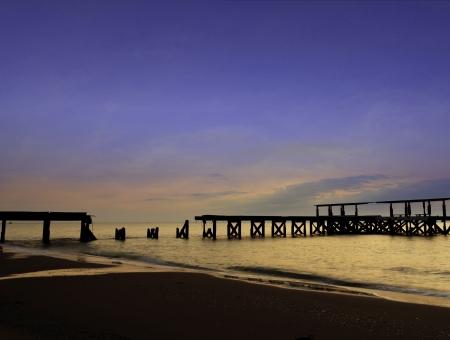 collapsed bridge in the sea with twilight sky  Stock Photo