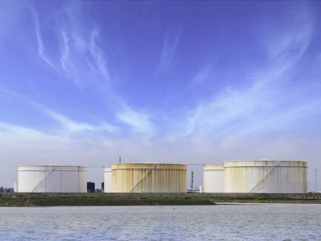 large storage tanks  for petrol and oil with blue sky background