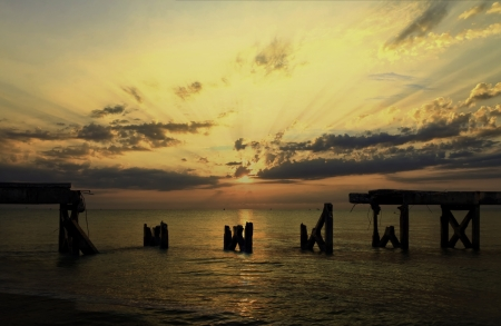 collapsed bridge in the sea with sunrise  Corroded bearings and collapsed concrete flooring