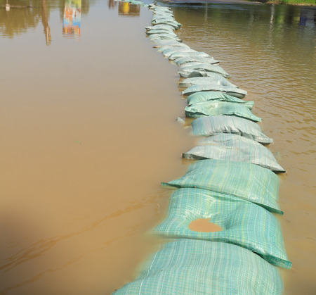 sandbag: row of sandbags for flood protection