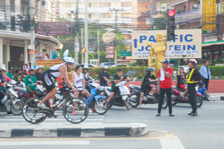 unidentified: PATTAYA - OCT 17, 2015: Side view of unidentified  triathlete cycling in the Pataya Triathlon 2015 event October 17, 2015 in Pattaya, Thailand.