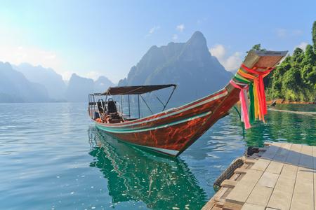long lake: Long tail boat against mountain and lake. Chiao Lan dam,Surat Thani , Thailand. Stock Photo