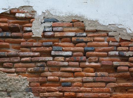 cracked concrete vintage brick wall background.