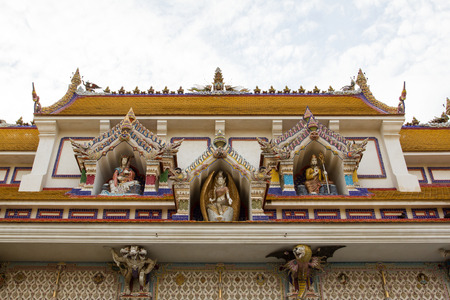 kingdom of heaven: Wat Pariwat Temple roof showed heaven kingdom with many god statue on blue sky background, Rama 3 road, Bangkok, Thailand