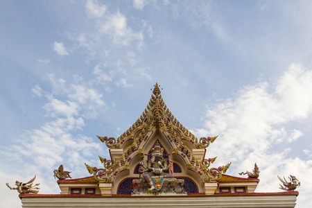 jade buddha temple: Wat Pariwat Temple roof showed jade emperor statue and heaven kingdom on blue sky background, Rama 3 road, Bangkok, Thailand