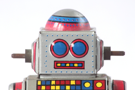 tin robot: isolated straight face vintage tin robot close up on white background