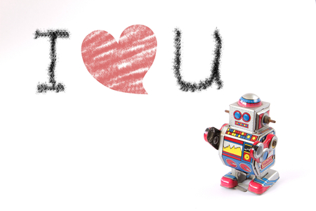tin robot: isolated standing vintage tin robot, oblique view without key on white background with text I love u for valentines day