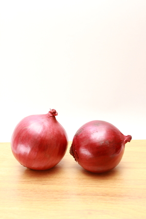 aftertaste: two red onion on wooden top