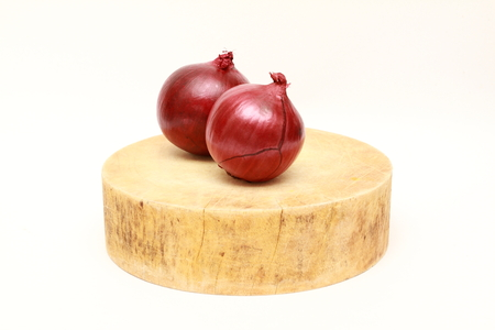 aftertaste: two red onion on asian traditional wooden cutting board Stock Photo