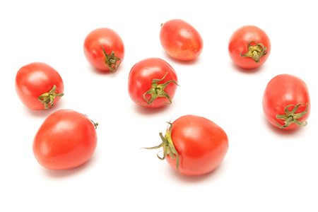 cluster: isolated tomatoes cluster on white background Stock Photo