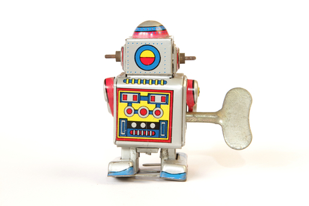 tin robot: isolated standing vintage tin robot, back view with key on white background Stock Photo