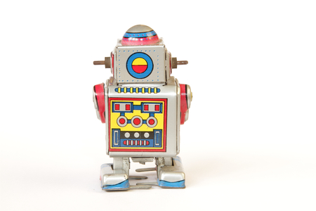 tin robot: isolated standing vintage tin robot, back view without key on white background Stock Photo
