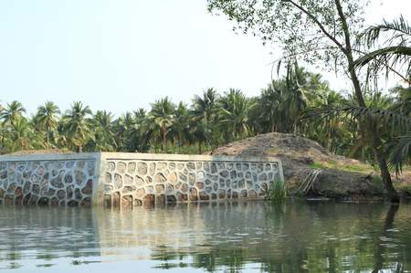 land slide: concrete and rock dam on river bank to prevent land slide