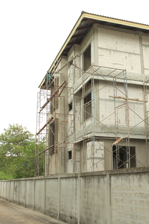 three story: exterior of a new three story home under construction with autoclaved aerated concrete wall panel