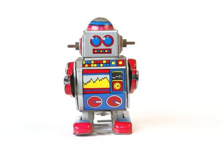 tin robot: isolated vintage tin robot toy, straight face without key on white background