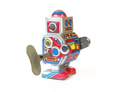 tin robot: isolated vintage, retro tin robot toy, oblique view with key on white background