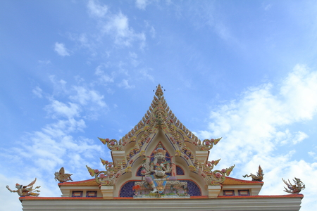 showed: Wat Pariwat Temple showed imeginary king of god statue at church gable with blue sky background