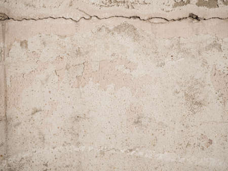 Abstract pale pink painted old concrete wall, peeling off  for texture and background