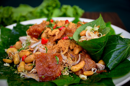 asia food: Pork and cashews wrapped in Chaplo  delicious of Thaifood.